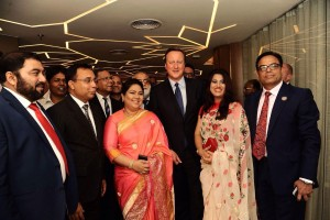 David Cameron with Enam Ali and guests